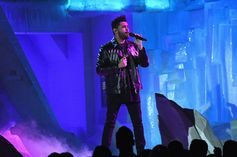 The Weeknd captured on stage in a custom made Loveblade leather jacket by Pierpaolo Piccioli at last night's Recording Academy GRAMMY's.