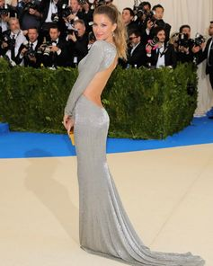 Gisele walks the red carpet at the #METGala2017 wearing a bespoke embroidered gown for the #GreenCarpetChallenge crafted from certified organic silk featuring all over glass bead embroidery.