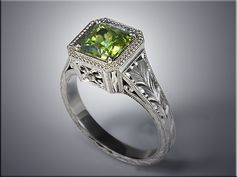 p527  14K white gold green sapphire ring in antique style mounting with hand engraving.  Designed and made by Tim Frank.