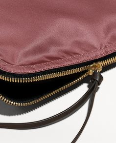 A durable pouch with a zip-top closure and leather zip pull. The versatile piece can be used a beauty bag or clutch, with protective lining lending a functional edge.