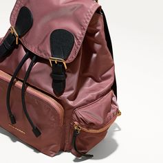 The Rucksack – a military inspired design detailed with multiple zip-fastening pockets and woven in a showerproof technical nylon.