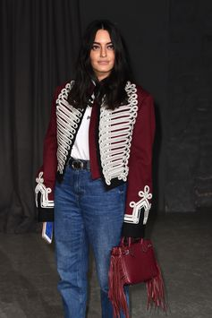 Karen Wazen wearing a Burberry wool cavalry jacket, carrying the fringed Baby Banner at the February Show in London