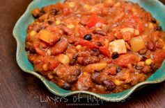 Easy Slow Cooker Vegetarian Chili - Layers of Happiness - A variety of vegetables, a rich tomato base, and just the right amount of spice make this vegetarian chili especially delicious and perfect on a chilly night.