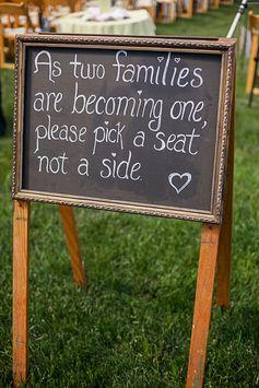 """two families become one"" wedding seating chalkboard sign #chalkboardsigns #ceremonyseating #chalkart http://www.weddingchicks.com/2013/11/01/diy-barn-wedding-2/"