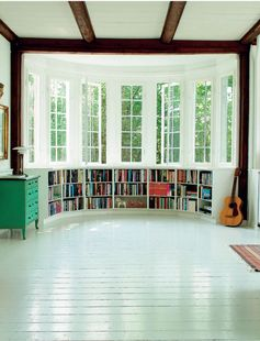 Curved bookshelf under window