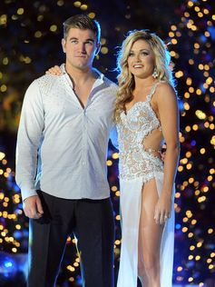 Alek Skarlatos and partner Lindsay Arnold embrace at ABC's 'Dancing with the Stars' Season Finale.