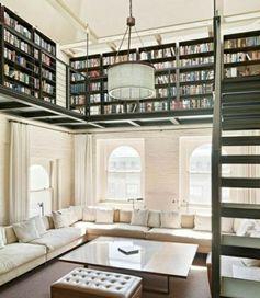 Loft with bookshelves wall. Penthouse bookshelf designs wall living room. Interesting bookshelf