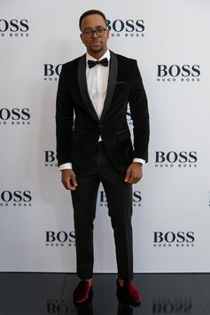 Maps Maponyane wearing BOSS for the Cape Town store opening