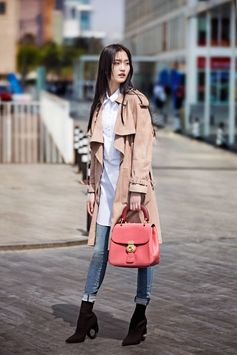 Model Wang Xin Yu wearing a Burberry suede trench coat with cotton shirt, jeans and knitted boots, carrying The DK88 bag in Beijing on 6th Apr, 2017