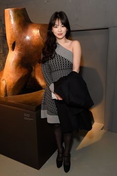 Hye Kyo Song wearing a one-shoulder knitted dress from the February collection to attend the runway show in London