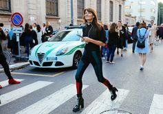Marie-Amelie Sauvé in Louis Vuitton pants and boots