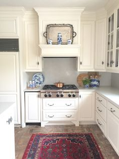 Symmetrical White kitchen, hidden ice maker, mantle over range, pots and pans drawers | http://11gables.blogspot.com