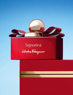 "In festive red with a golden bow, a special holiday edition of ""Ferragamo Signorina"", the signature scent for women. holiday.ferragamo.com/"