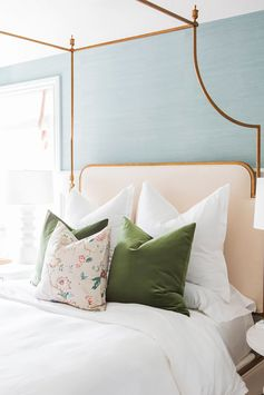 Refreshing bedroom with feminine details such as mint walls and gold framed bed