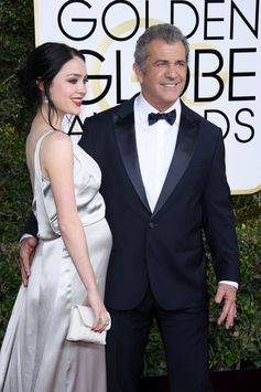 Nominee Mel Gibson and Rosalind Ross both walked the red carpet in Giorgio Armani outfits at the 74th Annual Golden Globe Awards. #ArmaniStars