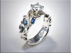 14K White Gold Floral Design Mounting with Marquise Shape Sapphires.  Designed and made by Ron Litolff
