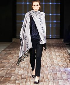 Draped in Style For a sophisticated, subtle take on the trend, toss on a fringe-trimmed scarf or shawl, like this luxe piece from Thomas Rath's Fall 2015 runway show.