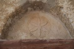 Six petal flower above the door of orthodox chapel More complex intersecting circles pattern on the both sides of the center circle when zoomed. Found from Chora, Patmos, Greece. Undated.