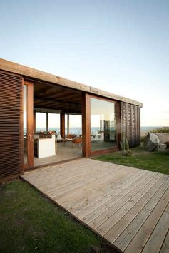 I adore the simple glass and wood sliding door design which blends in seamlessly with the stunning views