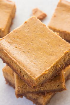These Pumpkin Cheesecake Bars have a sweet, spicy, soft filling and are married with the most amazing Biscoff Cookie Crust! Perfect for those cheesecake cravings when you're on the go!