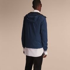 A light, hardy hooded jacket suited to the vagaries of travel. Constructed with a seam-sealed technical shell, it has protective drawcords and elasticated cuffs to resist the elements. It is designed to fold neatly into the accompanying packaway bag, ideally sized for a rucksack or weekend carryall.