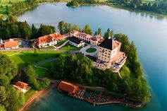 When experiencing Europe, a retreat to Schloss Fuschl in Austria is the perfect romantic getaway to recharge the batteries. Built in 1450 as a summer residence for archbishops, the castle sits on 85 manicured acres that stretch into a private lake. Enjoy housemade schnapps while enjoying the hunting lodge-esque decor.