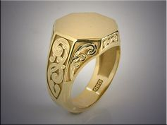 14K yellow gold gents signet ring with raised sections of hand engraving
