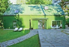 Gotta love green. The seating area is a great place to relax, and the stone walkway breaks up the lawn (which is the same color as the house).