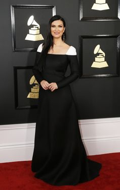 Italian beauty Laura Pausini wore a Valentino Fall/Winter 2016-17 Haute Couture black and ivory silk gown to the 59th GRAMMY awards ceremony in Los Angeles.