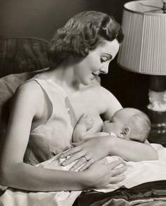 Vintage photo of breastfeeding mother