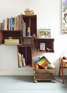 Credit: Rachel Whiting Wall-hung vintage crates make attractive display units for toys, games and books. The crate on casters, when emptied ...