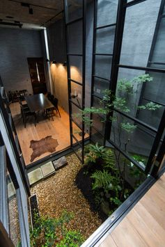 Double-height Ceiling with Sliding Doors and Garden Courtyard