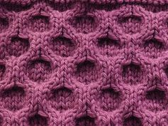 honeycomb stitch (personal pattern for blanket pattern use 72 sts. 4 rows seed st. 4st each end for border in seed st. 8mm needles. super bulky yarn)