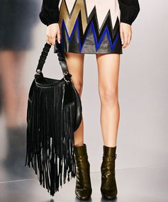 The Longer, The Luxer The longer the fringe, the better. At least that seems to be Emilio Pucci's view, evidenced by this Western-inspired leather bag from his Pre-Fall 2015 collection.
