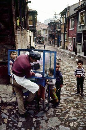 Cotton candy vendor in the district of Zeyrek, Istanbul, 1970.  [Credit:Ara Güler]