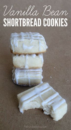 Delicious & tiny Vanilla Bean Shortbread Cookies. Topped with a Vanilla Bean Drizzle for the perfect little sweet treat.