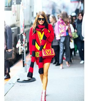 On Our Radar: Fast Food Fashion - Anna Dello Russo:  You can always count on Dello Russo to wholeheartedly embrace bold fashion, so we weren't surprised when she stepped out in Moschino's F/W 14 collection immediately after the show.  Moschino Special Edition Sweater ($780) in Red