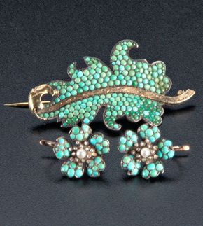 """Turquoise pavé and gold jewelry, ca. 1850, comprising: a pair of floral earrings with RC diamonds and pearl centers, and a silver-topped gold leaf brooch. Earrings: 1 1/2"""" dia; brooch: 2 1/2"""" x 1 1/2""""."""