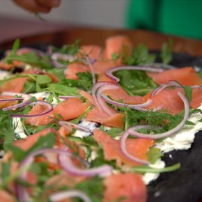 Squid Ink Flatbread with Smoked Salmon - Enjoy lox with cream cheese on top of a deliciously briny squid ink flatbread.
