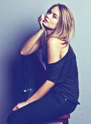 Natalie Morris - Option Model and Media sitting pose on stool blond hair loose clothing fashion modeling portraiture