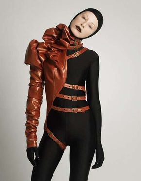 Strap-Happy Couture - Mother of London is a conceptual couture brand headed up by Mildred von Hildegard that blends steampunk style with fetish fashion and Gothic tendencies.