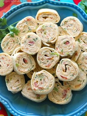 Chicken Enchilada Roll Ups - These Chicken Enchilada Roll Ups are a great appetizer for parties! Easy to make ahead and easy to serve. the-girl-who-ate-everything.com