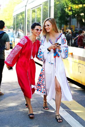 Le Fashion Blog Street Style Easy Summer Look Sunglasses Colorful Embroidered Latin American Inspired Dresses Black Sandals Via NYTimes