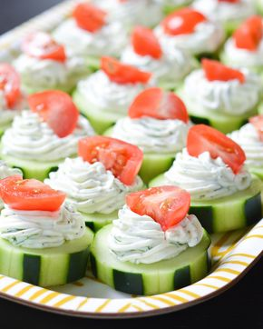 Dilly Cucumber Bites - These fresh Dilly Cucumber Bites make a great healthy appetizer. Cucumber slices are topped with a fresh dill cream cheese and yogurt mixture, and finished with a juicy cherry tomato.