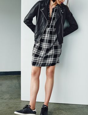 Trending: pair a leather jacket with a flannel shirtdress and sneakers for a sporty street-style look.