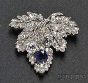 Art Deco Platinum, Sapphire, and Diamond Leaf Brooch, Paul Flato, set with a cushion-cut sapphire measuring approx. 6.50 x 6.50 x 4.00 mm, and two old European-cut diamonds weighing approx. 1.12 and 1.20 cts., further set with old mine-, old European-, and single-cut diamonds, 1 1/2 x 1 3/8 in., signed, with photocopy of receipt dated December 3, 1935. by chrystal