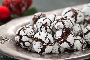 Chocolate crinkle cookies! Chocolate dough rolled in powdered sugar and baked into a festive black and white cookie. Perfect Christmas cookies!