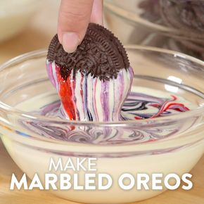 Lose Yourself to These Tie-Dye Oreos - In three easy steps, you can go from a normal package of Oreos to a chocolaty, marble-swirled cookie display that would be perfect for any bridal shower, a holiday event, or even a kid's party!