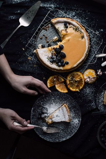 Classic Cheesecake with Hazelnut Crust and Citrus Topping