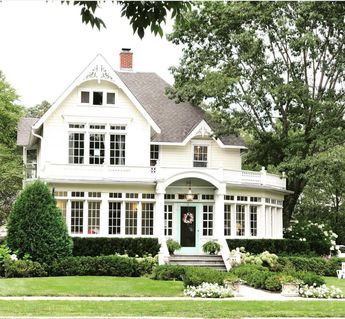 Gorgeous design! Absolutely love the curved room on the right. I think there is a deck above the righthand room. Cannot see a doorway, but it looks like a deck space. And of course, I love, love, love all the beautiful mullioned windows.